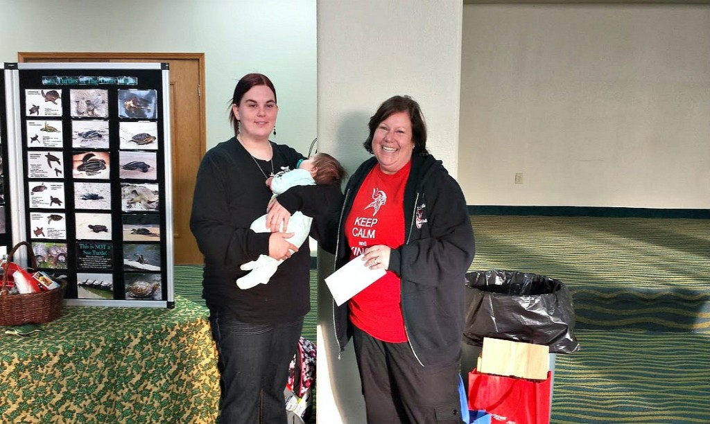 N.E.S.T. Education Chair, Elaine Lubosch accepts a donation from Stokesdale Elementary School (little baby Simone was supervising !)