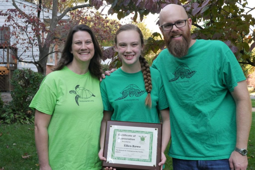 Ellen and her parents with their tees for turtles shirts